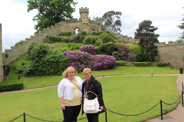 Kylie and her Grandma posing at Warwick Castle